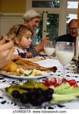 Stock Photograph Of Family Eating Thanksgiving Dinner X10483519