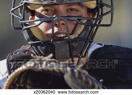 Stock Photography Of Baseball Catcher In Catchers Mask Holding