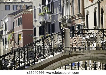 Stock Photograph Empty Bridge With Wrought Iron Hand Railing Over River In Old City Area