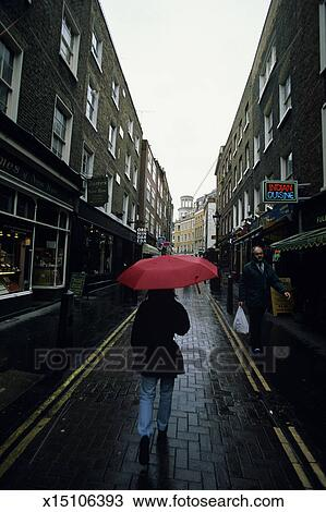 Stock Photo Of Woman With Umbrella Walking Down Street London