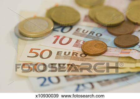 'Euro coins and notes fanned out, in studio' Stock Photo