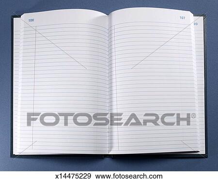 stock photograph of open blank notebook with lined paper overhead