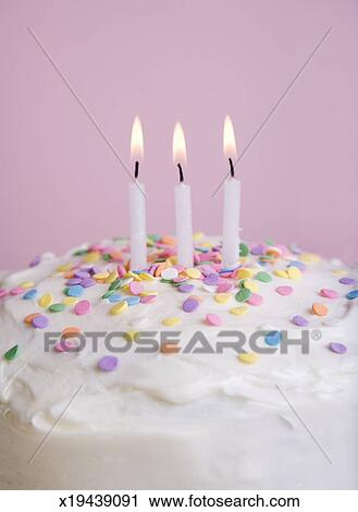 Birthday Cake With Sprinkles And Three Lit Candles Close Up