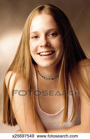 Stock Photograph Of Teenage Female Girl With Long Dark Blonde Hair