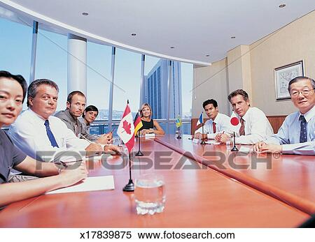 stock image of portrait of a group of business executives sitting