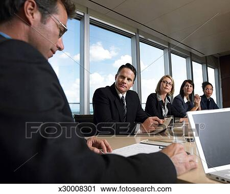 Super Business Executives Listening To Their Ceo At A Conference Room Meeting Stock Image Home Interior And Landscaping Ponolsignezvosmurscom