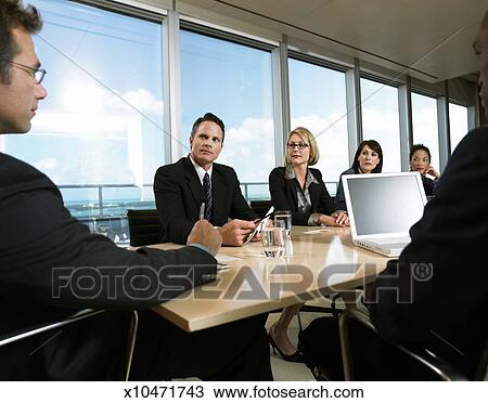 stock photo of business executives listening to their ceo at a rh fotosearch com