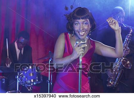Female Jazz Singer Sings Into a Retro Microphone, Clicking ...