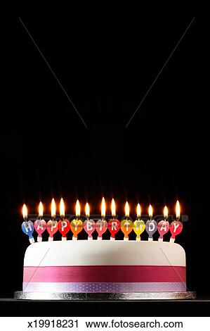 Stock Photography Of Iced Cake Lit With Happy Birthday Candles
