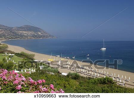 Cyprus Polis Rows Of Sunbeds And Parasols On Beach Elevated View Stock Image