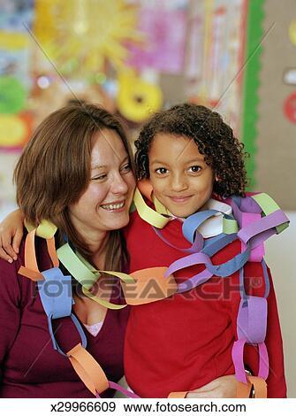 Schoolgirl 5 7 With Teacher Wearing Paper Chains Portrait