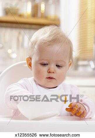 Excellent Baby Girl 8 10 Months Sitting In High Chair Putting Hand Short Links Chair Design For Home Short Linksinfo