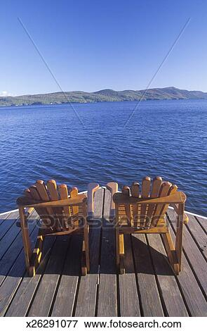 Two Adirondack chairs on a deck overlooking Lake George, NY ...