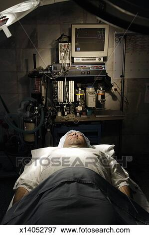 Man On Surgical Table In Operating Room Stock Photo X14052797