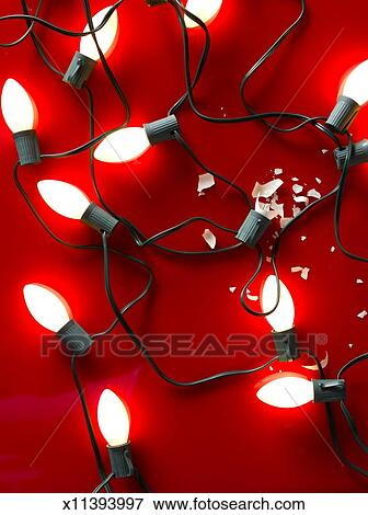 Christmas Lights With One Broken On Red Background Stock