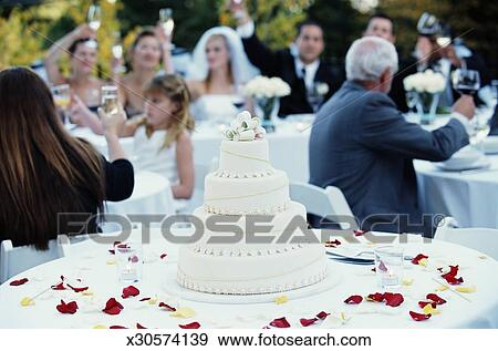 Stock Photograph Of Guests Raising Toast At Wedding Reception Focus