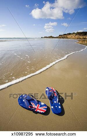 02e013553fcc Stock Image of Australian flag thongs on beach x10987295 - Search ...