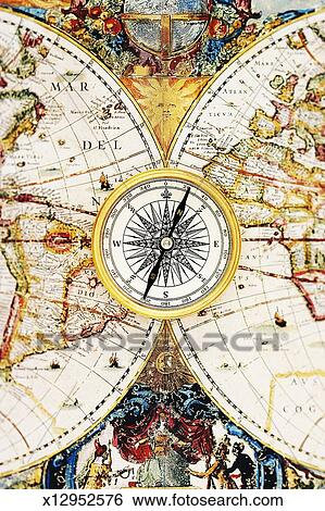 Compass Rose On Detail Of Old Fashion World Map Close Up Stock