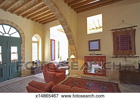 Picture of Entrance hall and living area of Mediterranean town house ...