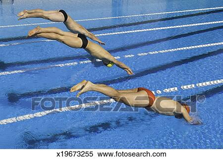 Competitive Swimmers Diving Into Swimming Pool