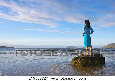 picture of ireland ulster county donegal woman standing on rock