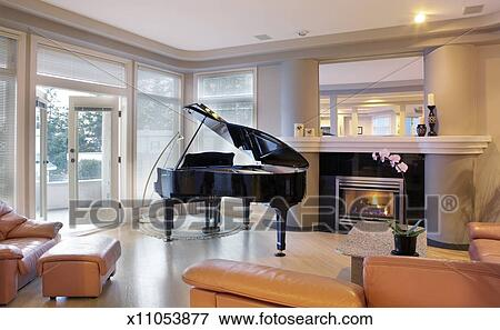 Openhaard In Woonkamer : Beeld piano naast openhaard in woonkamer x11053877 zoek
