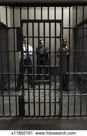 stock photography of woman and two men in prison cell portrait