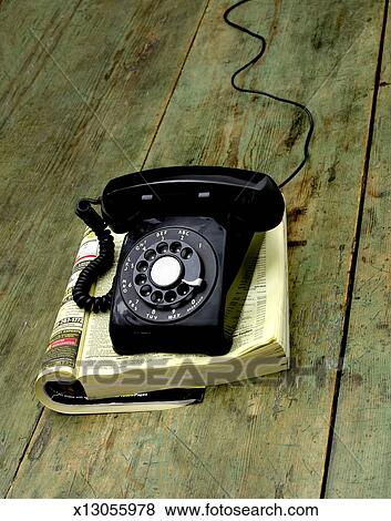 Pictures Of Old Fashioned Phone On Phone Book On Wooden Table