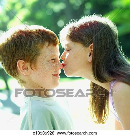 Pictures Of Young Girl Kissing A Young Boy 8 11 On His Nose