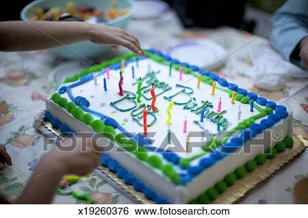 Outstanding Hands Taking Candles Off A Birthday Cake Stock Photograph Funny Birthday Cards Online Amentibdeldamsfinfo