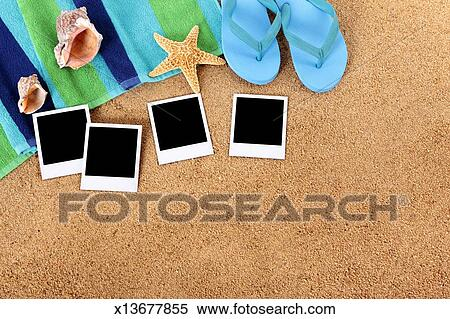 stock image of beach background with blank polaroid photo prints