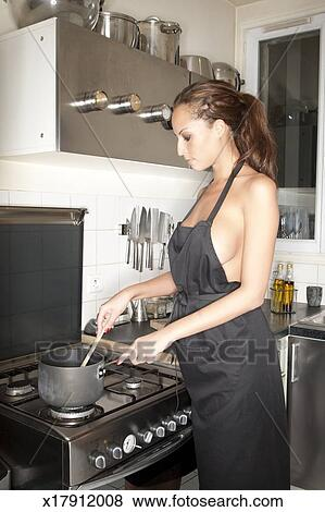 pictures of woman wearing apron cooking food in kitchen x17912008