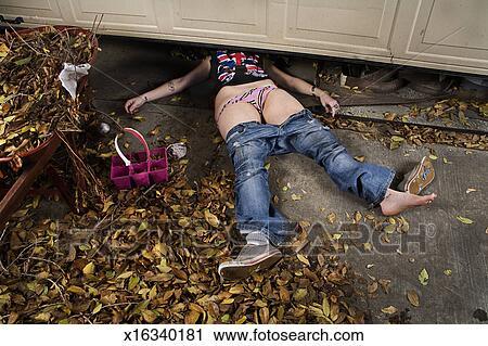 Stock Photography Of Woman Accident Under Garage Door X16340181