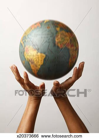 stock images of 2 hands poised under moving globe x20373666 search