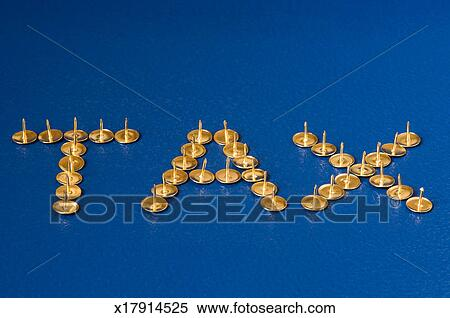 stock image of thumb tacks spelling the word tax x17914525 search