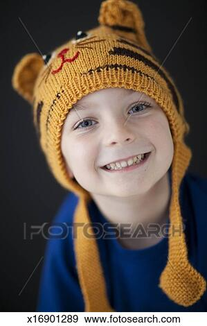 7aaa9bc11d1 Stock Photograph of Smiling little boy wearing a tiger hat ...