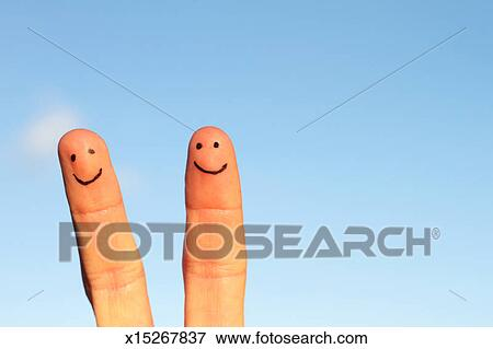 Smiley Face Peace Fingers Against The Sky Stock Photo