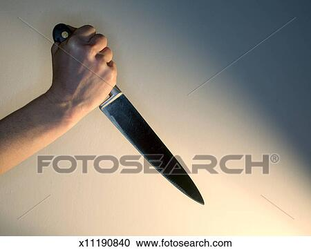Hand Holding A Large Kitchen Knife
