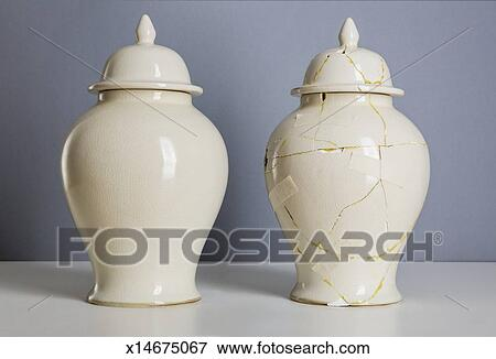 Picture Of Cream Coloured Vase Next To Broken Repaired One