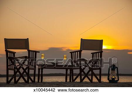Beach Table And Chairs For Two At Sunset