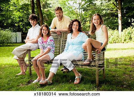 Stock Photo Of Happy Family Portrait On A Park Bench X18180314
