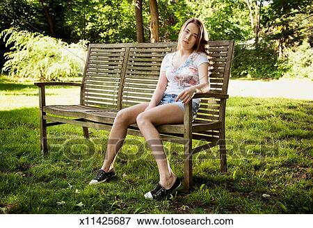 Prime Teen Girl Sitting On Wooden Bench Stock Photo X11425687 Ocoug Best Dining Table And Chair Ideas Images Ocougorg