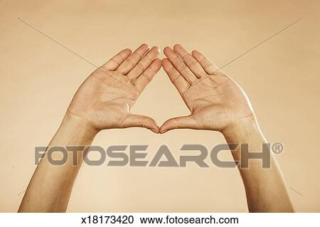 stock photography of hands making triangle formation plain