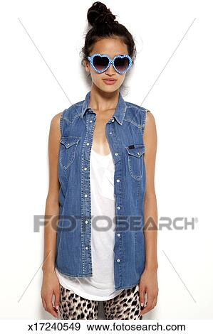1b507b3762966 Stock Photograph - Teenage model in heart shaped glasses. Fotosearch -  Search Stock Photography