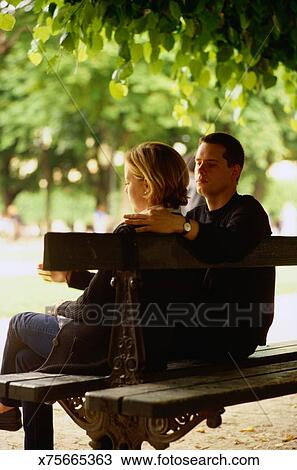 Stock Photo Of Couple Sitting On A Park Bench X75665363 Search