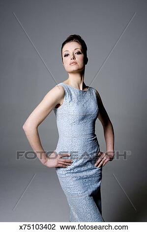 stock photo of 3 4 length portrait beehive hairdo hands on hip head