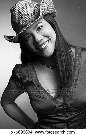 Stock Photo - Woman wearing cowboy hat. Fotosearch - Search Stock Images 81887071b6a3