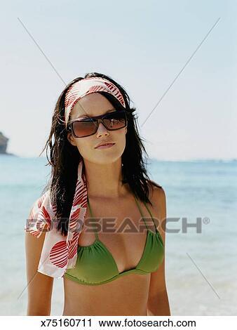 fdc16d7cf8 Stock Image - Young woman on beach wearing bikini