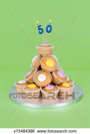 50th Birthday Candles On Pile Of Fairy Cakes