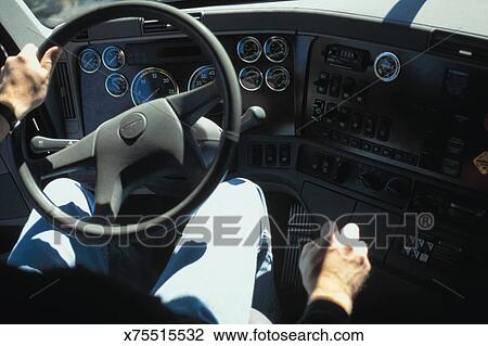 Interior view of man driving truck Stock Image